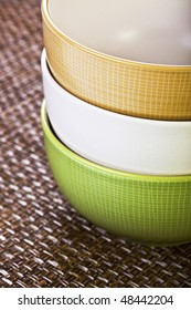 Stack of Three Multi-colored Bowls on Placemat