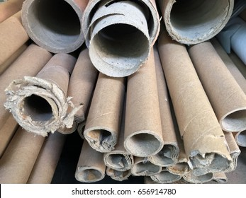 Stack together of old paper core. pile of brown paper tubes.