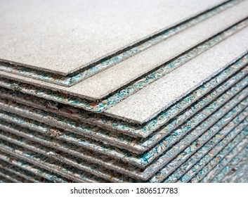A stack of tongue-and-groove moisture resistant particle board