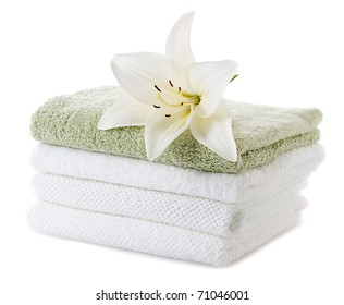stack of towels with white lily isolated on white background