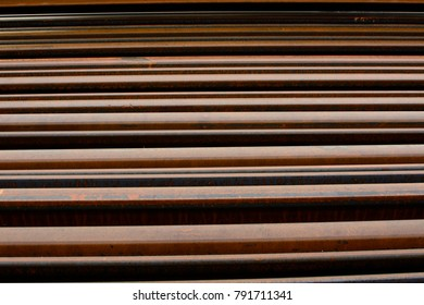Stack of tramway rusted rails