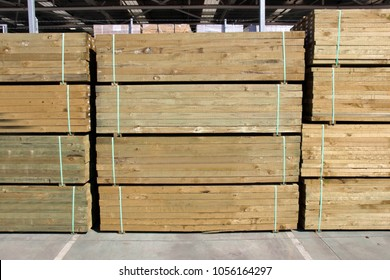 Stack of treated pine lumber
