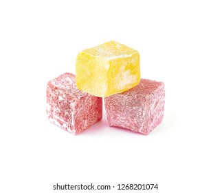 Stack of turkish delights or fruit jelly isolated on white background. Delicious oriental sweets