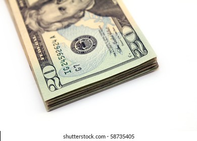 stack of twenty dollar bills over white background