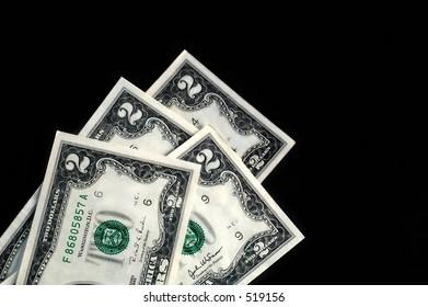 stack of two dollar bills