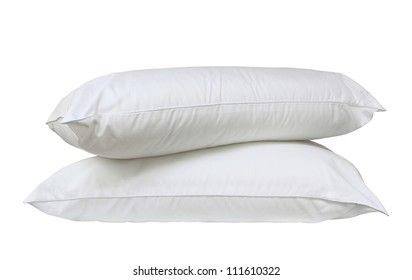 Stack of two fresh, new white bed pillows isolated over white