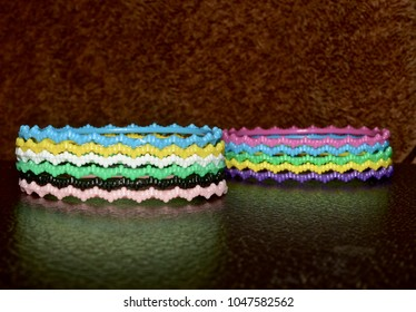 Stack of unique bracelets isolated fashion object unique stock  photograph