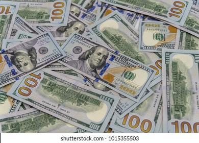 a stack of us 100 dollars cash with white background