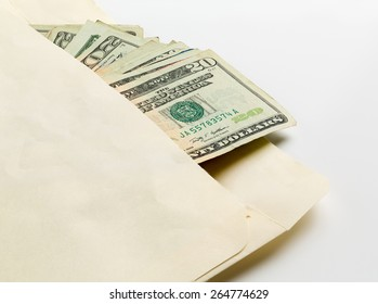 Stack of used $20 US currency bills or notes in an envelope in a concept photo for a bribe or payment