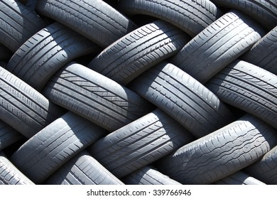 Stack of used car tires in the garage