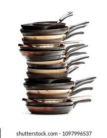 Stack  of used frying pans isolated on white