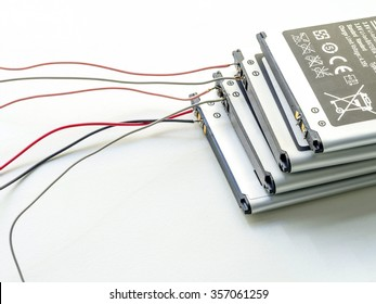 stack of used lithium-iron battery with wire, the battery removed from mobile phone