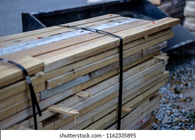 Stack of used lumber on a construction site