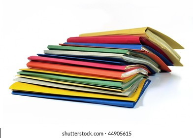 Stack of various colored office files with documents isolated on white