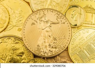 stack of various golden coins, business background, background made of precious coins made of pure gold from above, golden austrian phillharmoniker, golden american eagle, golden kangaroo australia
