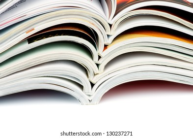 Stack of Various Open Magazines closeup on white background