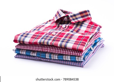 Stack of Various Plaid Men's Shirts isolated on white background