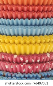 Stack of Vibrant Cupcake Wrappers Close Up Background.