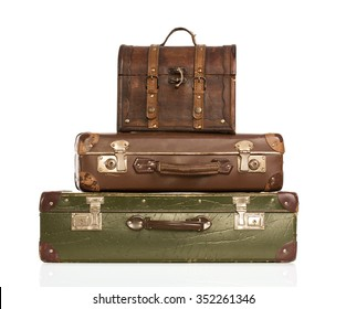 Stack of vintage leather suitcases isolated on white background