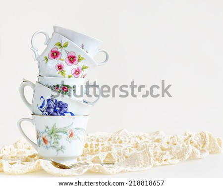 Stack of vintage tea cups for high tea