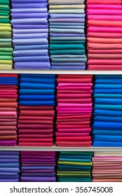stack of vivid color thai silk fabrics