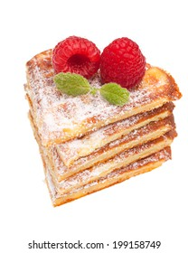 Stack of waffles with raspberries