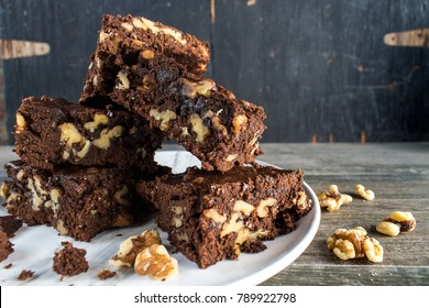 stack of walnut brownies in rustic setting
