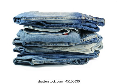 Stack of washed-out blue denim jeans
