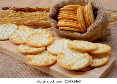 stack of water cracker on wooden table