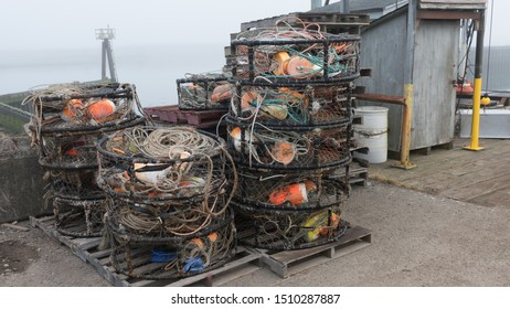Stack of West Coast Crab Traps stacked up dockside. Commercial fishing concept.