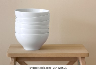 stack of white bowl on table