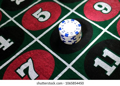 Stack of white chips on number 8 on a roulette layout