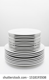 stack of white plates isolated on white