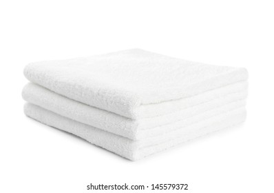 stack of white towels isolated on white