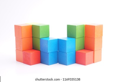 stack of wood cube building blocks