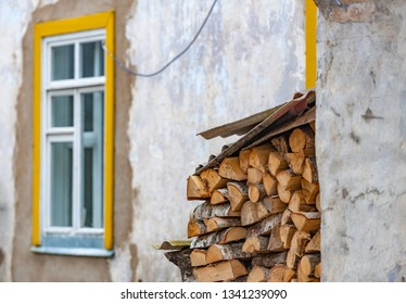 Stack of wood logs. Preparation of firewood for the winter. Pile of chopped lumber.