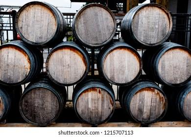 A stack of wooden barrels