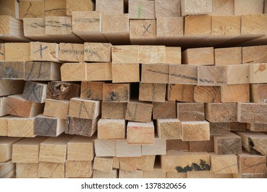 Stack of Wooden Boards from ends. Natural photo.