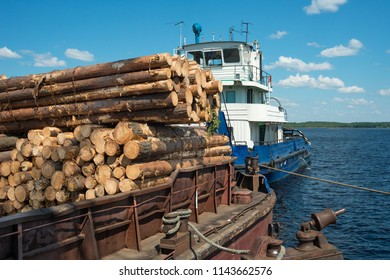 Stack of wooden logs ready to transport. Logging and transportation of wood