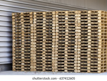 Stack of wooden pallets in the factory.