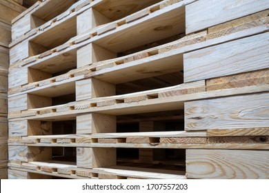 stack of wooden pallets inside a warehouse