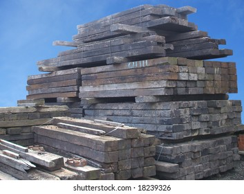 A Stack of Wooden Railway Sleepers.