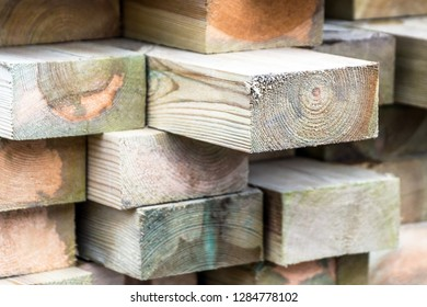Stack of wooden slats in timber logs storage