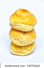 Stack of  yellow eclair  on white background