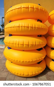 A stack of yellow pool floats awaits Summer fun.