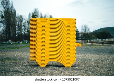 Stack of yellow sun beds at the lake side