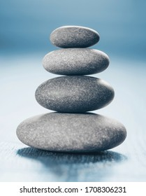 Stack of Zen Stones on blue background.