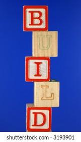 Stacked alphabet blocks spell build