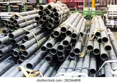 Stacked aluminum metal pipes. Heavy industry production