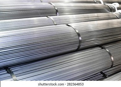Stacked aluminum  metal rods. Heavy industry production